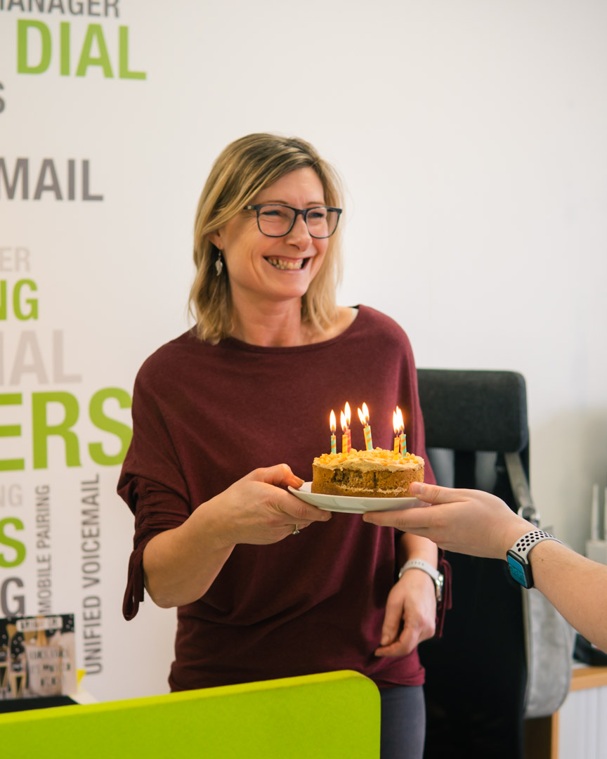 Happy Birthday! Provisioning team member, Dawn, receives a cake on her birthday from the SBC team