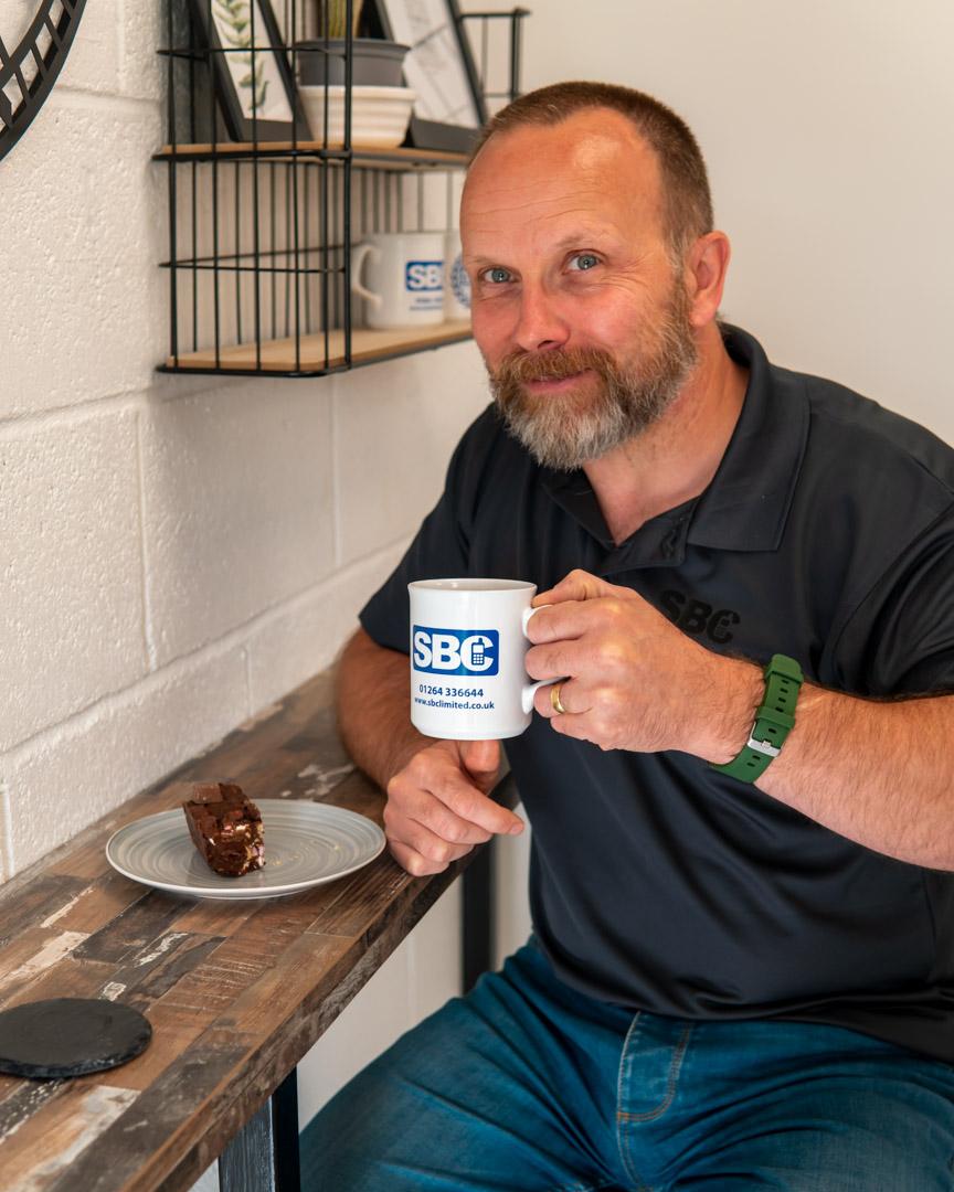 SBC team member Paul with his Bruno's Coffee Shop work anniversary cake