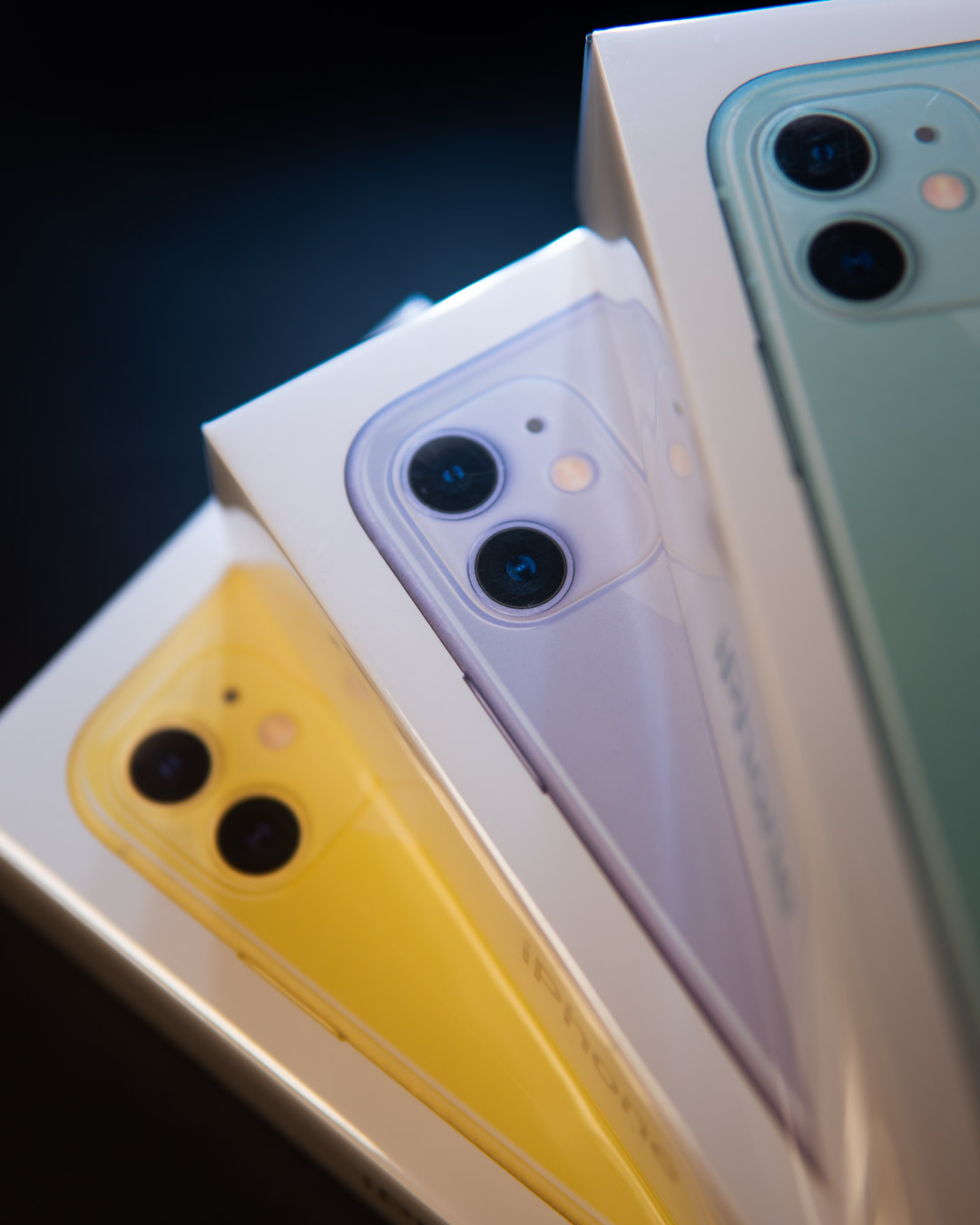 Black Friday Discounted iPhone 11 For Business Users - stacked yellow, purple and green iphone 11's