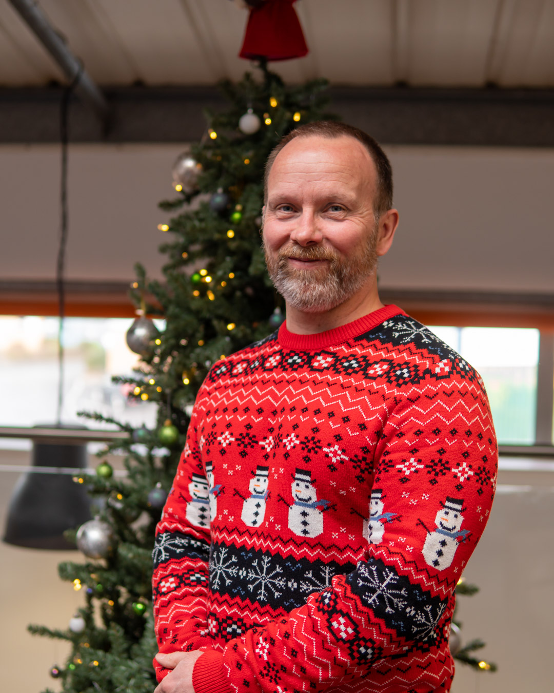 Christmas Jumper Day 2020: Paul wearing a snowman themed Christmas Jumper